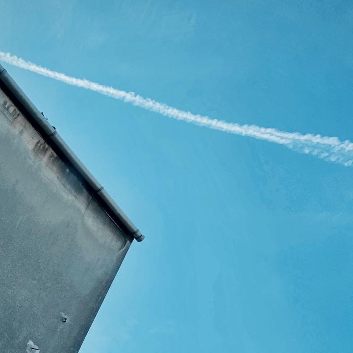 Contrail across a blue sky.
