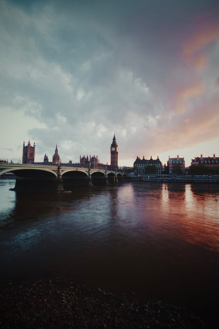Atmospheric sky over the Palace of Westminster and Westminster Bridge.