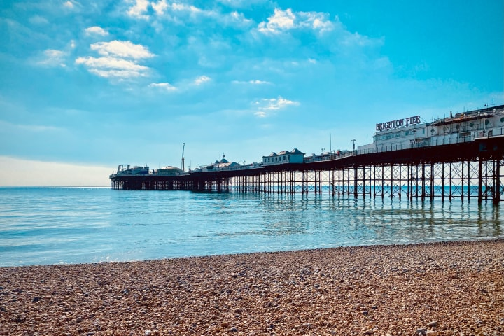 Brighton Pier against a bright blue sunny sky.