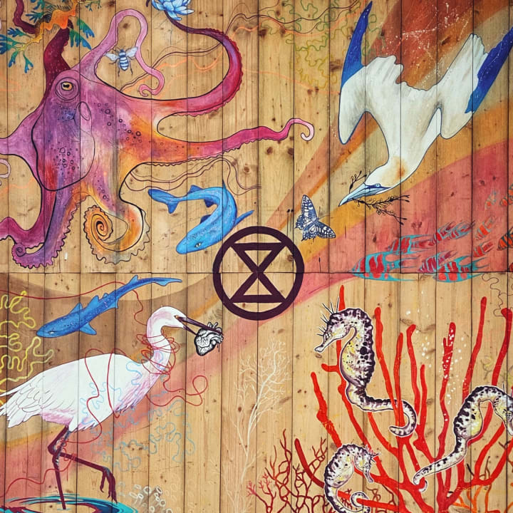 Extinction Symbol surrounded by illustrations of sea life.