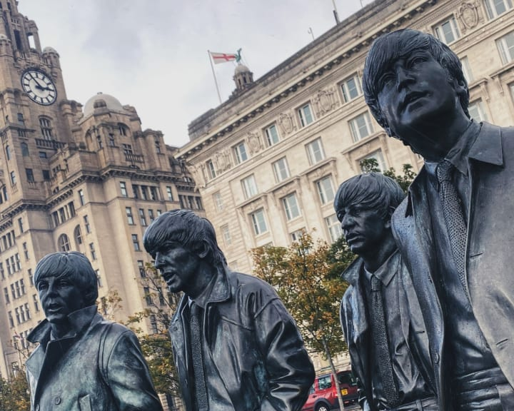 Statue of the Beatles in front of the Royal Liver Building.