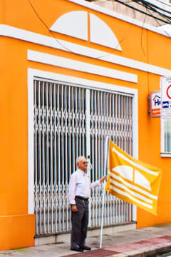 Resident holding an orange flag