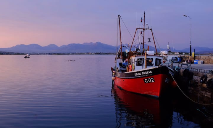 The Aisling Siobhan moored at Roundstone Quay.