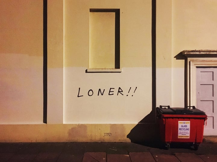 LONER!! written on a wall.