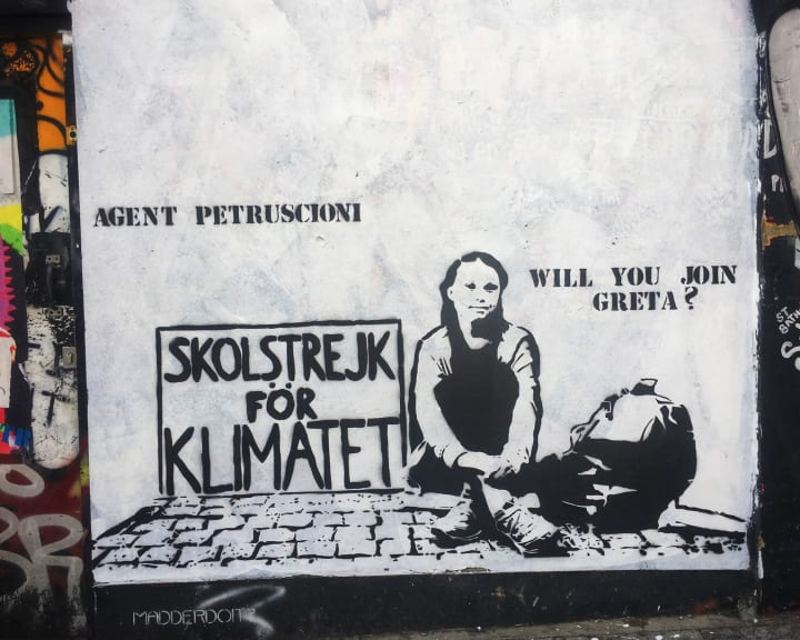 Graffiti of Greta Thunberg with the caption 'Will you join Greta?'.