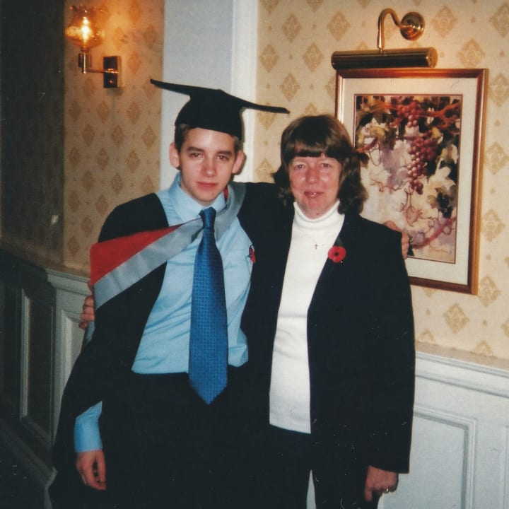 Me and mum at my graduation in 2002.