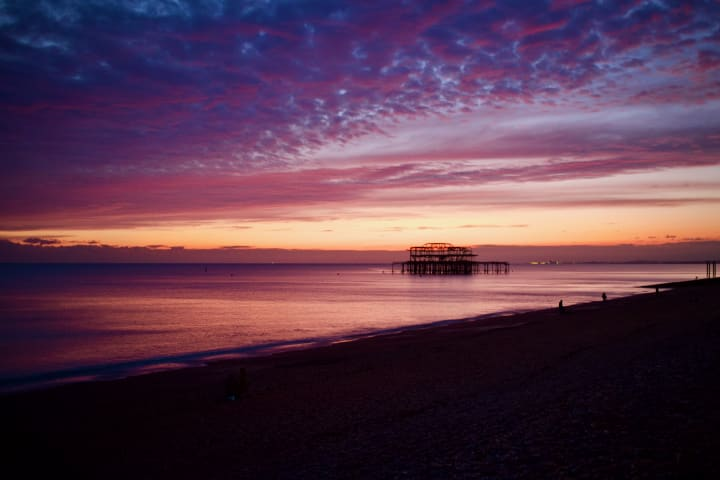 Sunset over Brighton's derilict West Pier.