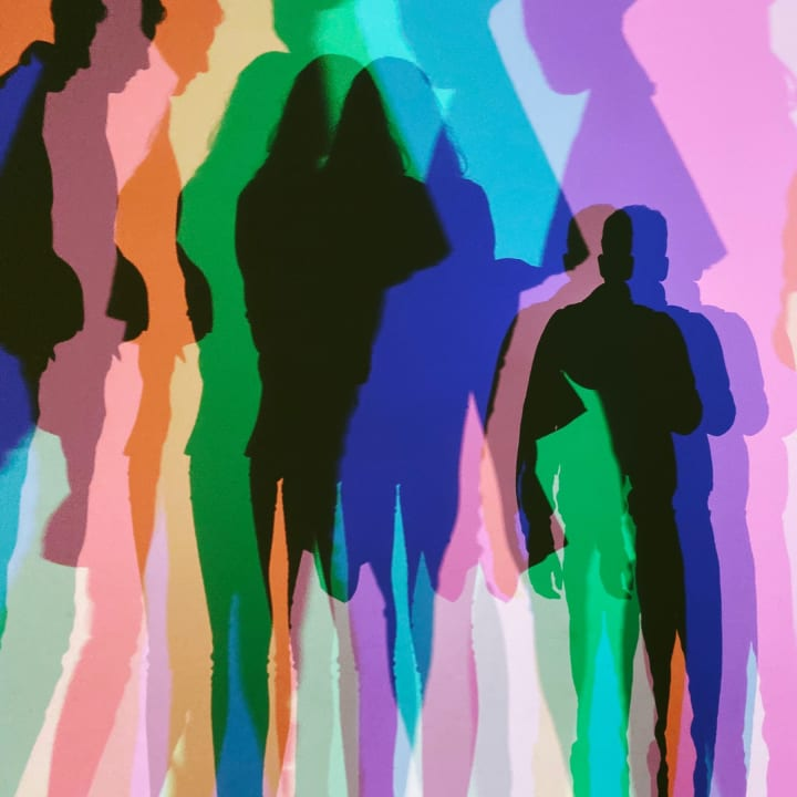 Multiple coloured shadows of people.