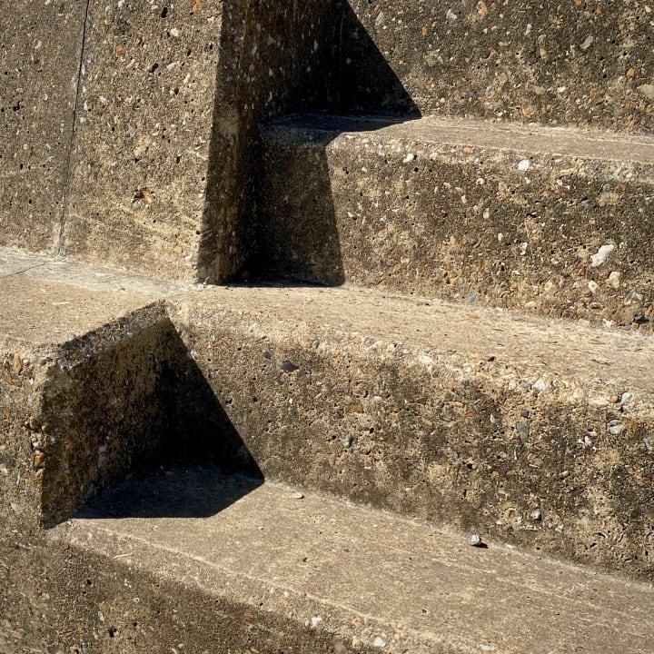 Harsh shadows on concrete steps.
