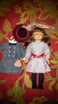 American Girl Doll Samantha, Retired 1980's Pleasant Company American Girl Doll Samantha with 2 full outfits, hat and purse. In excellent condition, no marks or stains. Not in box.