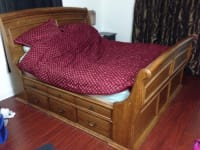 King size sleigh bed frame & matching dresser mirror, King size sleigh bed frame, with drawers underneath, heavy duty wood pieces. With matching dresser and mirror.