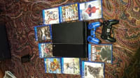 Ps4 with 9 games, Ps4 , 2014, 3 years old 2 controllers 9 games