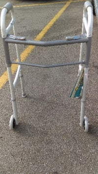 Medical walker, Guardian medical equipment walker with folding arms and wheels.