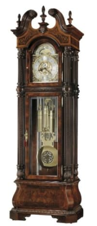 """Howard Miller 611-031 The J.H. Miller II Grandfather , The J.H. Miller II grandfather clock by Howard Miller Is finished in Windsor Cherry on sixteen different species of rare woods. Swan neck pediment crowned with three carved finials, two carved rosettes, and a carved finial shell, plus book matched Russian Walnut Burl with floral inlays framed with a Movingue border with Ebony and Maple accent lines. Ornate polished brass, Roman numeral dial features custom cast corners, center, and moon arch ornaments. The cast center disk is numbered and features a removable engraving plate for personal inscriptions. """"Limited Edition"""" is inscribed across the hemispheres. The dial includes a special brass finished moon phase. Decorative polished brass lyre pendulum features cast center disk with a spun silver background, and weight shells embellished with decorative bands with a silver-tone background."""