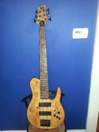 A bass guitar, Musical Instruments, Equipment, It is a six string bass guitar copy made by Fodera Bass company. It has EMG pickups and its 3 band eq, neck thru with .750 spacing.