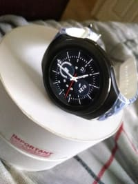 Samsung Gear S2, SM-R730T, 2015, Device is in excellent condition. Well taken care off, Battery Life is great. 1 full day of use and can even go to the next day. It has the latest update and it runs great! I also have the original box, charger, bands for large wrists and manuals. Also purchased a pair of blueish white bands!