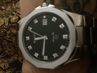 Watch, Bulova, Stainless steel link. Date and time. 100m water resistant. Battery powered.