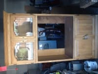 3 piece entertainment center , I have a 3 piece entertainment center with each cabinet has wheeled casters for easy moving , each cabinet has a working light light oak color stain.