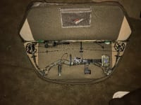 Diamond liberty compound bow, 2012 Diamond (Bowtech) camouflage compound bow, with matching quiver. Really nice shot and no major problems or marks, strings are stained from wax but that's a normal problem and honestly not a problem at all they won't need to be changed for years, it had an adjustable draw but set at 30, it's pull is 60 pounds and has a brand new sight, rest, and peep sock on it, also comes with release, case, arrows, and broadheads