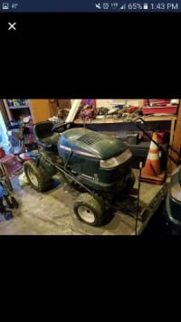 "riding lawn mower, Craftsman 22hp with 46"" cutting deck. Snowblade included. Wheel weights and chains. 