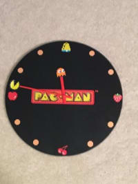 glass pac man clock, bought 5 years ago. glass. still works.