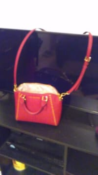 Michael kors purse, Brick and gold bag has long strap or carry strapless