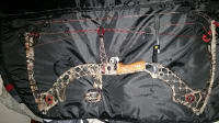 Mathews z7 xtreme, It is a Mathews z7 Xtreme. Lightly used. All camouflage. Has a 4 pin axion sight. With light. Draw weight of 70 pounds. Draw length of 27 inches