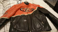 Harleyou Davidson Leather , Designer Wear & Handbags, Quality Harley brand women's leather. Traditional orange and black.