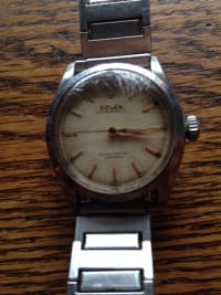1955 mens rolex wrist watch silver in color, Luxury Watch, Mens Rolex Oyster Perpetual Watch, This watch is silver in color with gold lettering on the face. Officially Certified Chronometer. Band is not Rolex. I believe it was made in 1954 and it still works.
