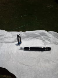 mont Blanc fountain pen, Metal is platinum and has a sapphire in the pen clip, Gently used