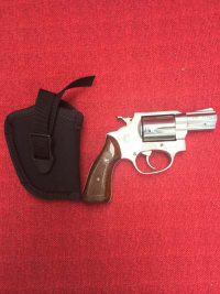Rossi 38 Special, Rossi 38 Amadeo. Silver 2 inch barrel 5 shot revolver. I box of ammo and holster serial# w240657, Gently used