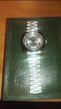 Rolex day/date II 41mm, Big Face 41mm Rolex day and date with blue dial, smooth bezel, Automatic sweeping second hand. New style bracelet comes with box. Authentic swiss replica. Solid watch and accurate movement, Like new