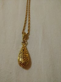 18 kt necklace with charm, 7.7grams, Older necklace with charm attached