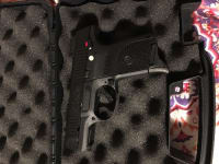 Pistol, Ruger SR9C, Carrying case, loading assist, and brand new cleaning kit