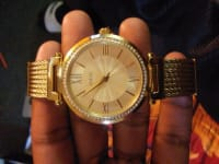 Guess watch , Guess , Its a gold coated water resistant stainless steel