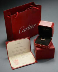 Cartier Trinity 3 Band Gold ring/ certified, his is a Cartier Trinity 3 band Gold ring with Certificate of Authenticity. 3 colors of gold.