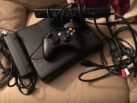 XBOX 360 W/ Kinect attachment, XBOX 360 (BLACK), 2012, hardly used, with controller, and Kinect attachment. Includes Need for speed, Midern Warfare 2, and Red Dead Redemption.
