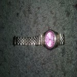 Michael Kors , Brand new watch, its gold with a pink face. I only took it out the box to take pictures
