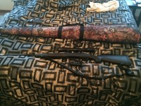 Savage Model 11 .243 Rifle with 9x40 scope and case , Gun, Camo Case and 9x40 Scope , Tear in foam base of rifle
