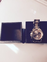 Michael Kors Rose Gold Watch, Luxury Watch, Michael Kors Rose Gold Men's Watch, Very nice watch however has a chip inside face. Not visible looking directly at the face but noticeable when viewed at an angle.