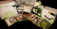 Xbox 360 Wifi HD Mega Bundle, Electronics, Xbox 360 Mega Bundle, XBOX 360 MEGA BUNDLE 14gb Wifi Meg Includes: 14GB Xbox360, wifi adapter, 2 wireless game controllers, 2 wireless handheld remotes (not in pic) additional controller charger stand, Xbox external HD DVD drive, and wired headset (not in pic). The 12 GAMES INCLUDED are: Call of Duty 2, Dead or Alive 4, Quake Wars Enemy Territory, Quake 4, NBA Live 06, Simpsons Road a Rage, Def Jam Fight for NY, Scooby Doo, Ninja Gaiden, Scarface, Mortal Kombat vs DC Universe, and Left 4 Dead 2. (All games also have original boxes except 2). Everything works perfectly and looks good.