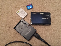 Nikon Coolpix s51, Electronics, Nikon Coolpix s51, Navy camera with memory card, rechargeable battery, and charger.