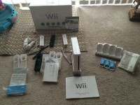 Wii Sports Gaming System , Electronics, Nintendo Wii, Complete system with lots of extras. 2 nunchucks, 4 controllers, 4 grip control covers, 4 motion plus controllers, 4 rechargeable batteries with charger. Original box with instructions and game.