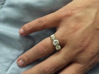 2ct diamond ring, Precious Metal or Stones, 2ct eternity ring, 18 Ct gold band. Two .50 ct side and one Carey center stone
