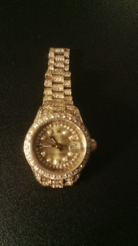 18k Gold Ladies Rolex Super Predential Watch, Luxury Watch, Rolex Super Presidential 18K Gold Watch W/Diamonds , Watch in great condition, number in diamonds, plus diamonds on the inside of the face and diamonds on the outside around the face and at the beginning of the band. watch also has gold face with datejust.