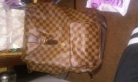 Britany Miller, Other, Brown Louis vuitton back pack purse slightly torn on the handle not the straps the handle of the purse