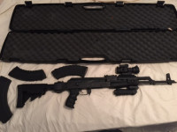 semi-auto ak 47 , Gun, banana clips and case, Very lightly used, is not fully auto