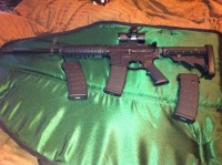 SW AR-15, Gun, 3-30 Mags, Laser Scope, SW-AR 15, with adjustable stock. with laser scope. and 3-30 round Mags.  Only used at the gun range 3-4 times and cleaned each time after. In like new condition.