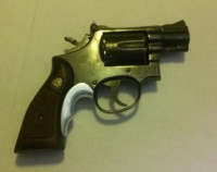 Smith & Wesson .38, Gun, 2 Speed Loaders, leather holster, This was my father's weapon, he passed it to me to be used as home protection. It is gently used, but fires beautifully. IT is a .38 Smith & Wesson Spl.  It has the original S&W wood grips with the brass S&W logo inset.