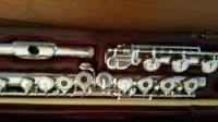 instrument flute, Musical Instruments, Equipment,  an Orpheo 715 RBE Model flute. The headjoint, body and footjoint are completely handmade in sterling silver, and the keys are silver clad. The headjoint is completely hand cut as well. It is an open hole model (plugs are supplied), Offset-G, with Split-E mechanism and a B foot. It also has French pointed arms which give accuracy and an agile response. This Orpheo model also adds hand-cut engraving to the rings and embouchure plate. The deep, rich engraving of the lip plate allows the player to precisely position the embouchure. It comes complete with a Wooden French style case and zipper fleece lined case cover, and cleaning rod.